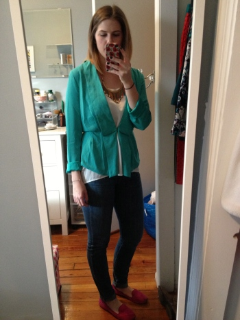 Teal blazer, white top, denim jeans, pink loafers and a multi-colored drop necklace.